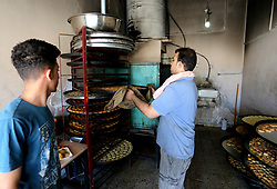 June 3, 2017 - Gaza City, The Gaza Strip, Palestine - Gaza City, Gaza Strip, Palestinian Territories - Preparing small cakes for Palestinians during the month of Ramadan  in Gaza City, the Gaza Strip, 03 June 2017 . Muslims around the world celebrate the holy month of Ramadan by praying during the night time and abstaining from eating, drinking, and sexual acts daily between sunrise and sunset. Ramadan is the ninth month in the Islamic calendar and it is believed that the Koran‰??s first verse was revealed during its last 10 nights. (Credit Image: © Mahmoud Issa/Quds Net News via ZUMA Wire)