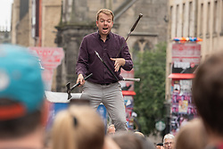 A juggler entertains the crowds on Edinburgh's Royal Mile.<br /> <br /> <br /> © Jon Davey/ EEm