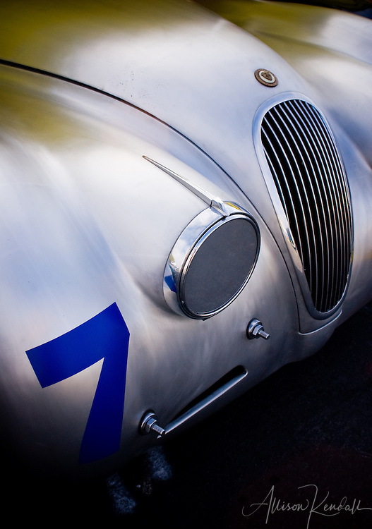 Soft, classic lines and afternoon light across the silver shapes of a classic Jaguar, seen at Laguna Seca during Monterey Car Week<br /> <br /> Prints: https://bit.ly/exquisite-curves-1