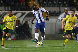 March 11, 2018 - Pacos Ferreira, Pacos Ferreira, Portugal - Porto's Cameroonian forward Vincent Aboubakar (C) in action with Pacos Ferreira's midfielder Assis (L) and Pacos Ferreira's Portuguese midfielder Pedrinho (R)during the Premier League 2017/18 match between Pacos Ferreira and FC Porto, at Mata Real Stadium in Pacos de Ferreira on March 11, 2018. (Credit Image: © Dpi/NurPhoto via ZUMA Press)