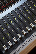 A close up of a vintage audio mixer sound equipment with control panel knobs and levels during an analog sound recording on the 31st August 2019 in London in the United Kingdom.