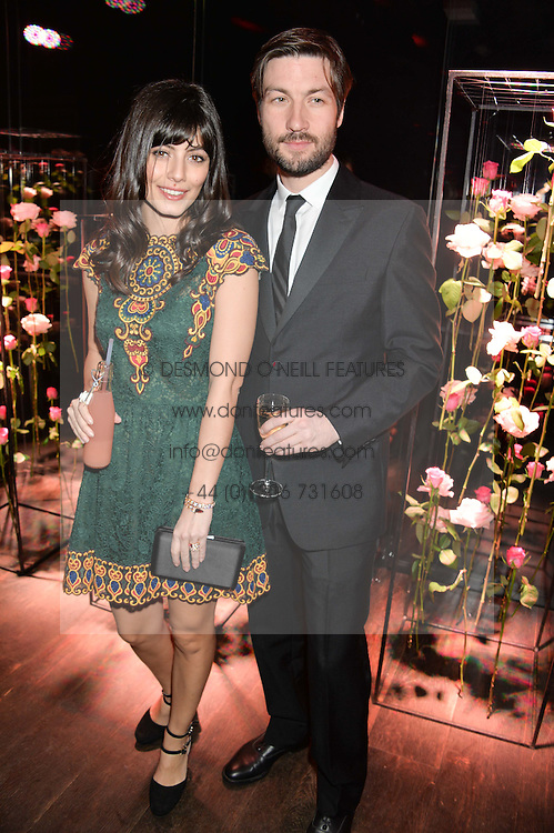 Actress ALESSANDRA MASTRONARDI and LIAM McMAHON at the Lancôme pre BAFTA party held at The London Edition, 10 Berners Street, London on 14th February 2014.
