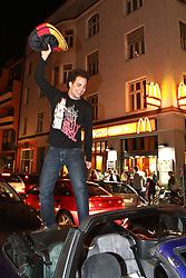 23.06.2010, Leopoldstrasse Schwabing, Muenchen, GER, FIFA Worldcup, Fanfeier nach Ghana vs Deutschland,  im Bild Fan auf Autokofferaum , EXPA Pictures © 2010, PhotoCredit: EXPA/ nph/  Straubmeier