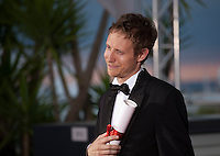 Laszlo Nemes with his Grand Prix award for the film  Saul Fia (Son of Saul) at the Palm D'Or award winners photo call at the 68th Cannes Film Festival Sunday May 24th 2015, Cannes, France.