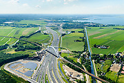 Nederland, Noord-Holland, Gemeente Muiden, 13-06-2017; Knooppunt Muiderberg, spoorbrug over de A1, de Zandhazenbrug in de avondschemering. Spoorlijn Almere-Amsterdam, Gooimeer. Muiderberg junction, near Amsterdam w railwaybridge. Foto richting Amsterdam, met skyline.<br /> luchtfoto (toeslag op standaard tarieven);<br /> aerial photo (additional fee required);<br /> copyright foto/photo Siebe Swart