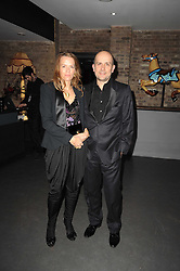 MARC QUINN and his wife GEORGIA at The Love Ball hosted by Natalia Vodianova and Lucy Yeomans to raise funds for The Naked Heart Foundation held at The Round House, Chalk Farm, London on 23rd February 2010.