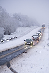 © Licensed to London News Pictures 28/12/2020, Cirencester, UK.Traffic on the A417 outside of Cirencester contend with overnight snow, spray and ice making for hazardous driving conditions. Photo Credit : Stephen Shepherd/LNP