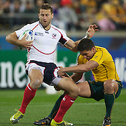 Kevin Swiryn, USA, is tackled by Anthony Fainga'a, Australia, during the Australia V USA, Pool C match during the IRB Rugby World Cup tournament. Wellington Stadium, Wellington, New Zealand, 23rd September 2011. Photo Tim Clayton...