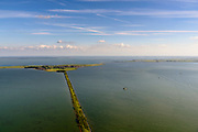 Nederland, Noord-Holland, Gemeente Waterland, 13-06-2017; het voormalig eiland Marken, nu met een dam verbonden met Waterland. Het omliggende water is het Markermeer (IJsselmeer, Zuiderzee). Rechts de Gouwzee, Gouwzeedam.<br /> The former island of Marken, now connected with a causeway (dam) to the mainland. <br /> luchtfoto (toeslag op standaard tarieven);<br /> aerial photo (additional fee required);<br /> copyright foto/photo Siebe Swart