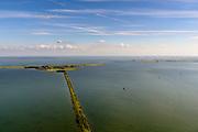 Nederland, Noord-Holland, Gemeente Waterland, 13-06-2017; het voormalig eiland Marken, nu met een dam verbonden met Waterland. Het omliggende water is het Markermeer (IJsselmeer, Zuiderzee). Rechts de Gouwzee, Gouwzeedam.<br /> The former island of Marken, now connected with a causeway (dam) to the mainland. <br /> luchtfoto (toeslag op standaard tarieven);<br /> aerial photo (additional fee required);<br /> copyright foto/photo Siebe Swart