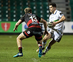 Glasgow Warriors' Adam Hastings under pressure from  Dragons' Tyler Morgan<br /> <br /> Photographer Simon King/Replay Images<br /> <br /> Guinness PRO14 Round 14 - Dragons v Glasgow Warriors - Friday 9th February 2018 - Rodney Parade - Newport<br /> <br /> World Copyright © Replay Images . All rights reserved. info@replayimages.co.uk - http://replayimages.co.uk
