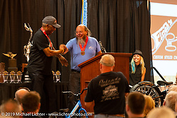 Legendary custom bike builder (and front end fabricator extraordinaire) Sugar Bear introduces new Hall-of-Famer Ron Finch at the Sturgis Motorcycle Museum & Hall of Fame Induction Breakfast at the Lodge at Deadwood during the Sturgis Black Hills Motorcycle Rally. SD, USA. Wednesday, August 7, 2019. Photography ©2019 Michael Lichter.