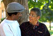 Friends age 70 having heart to heart talk in the park.  St Paul  Minnesota USA