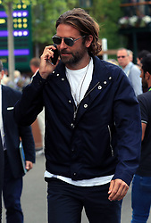 Bradley Cooper leaves the grounds following the Thomas Berdych and Roger Federer match on day eleven of the Wimbledon Championships at The All England Lawn Tennis and Croquet Club, Wimbledon.