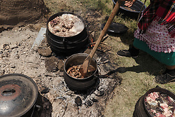 December 2, 2017 - Matatiele, Eastern Cape, South Africa - A Xhosa women prepares meat for an initiation ceremony at an open fire place. (Credit Image: © Stefan Kleinowitz/ZUMA Wire)