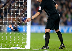 EDITORS NOTE: EXPLICIT CONTENT<br /><br />Referee Kevin Friend discards an item that was thrown on to the pitch during the match