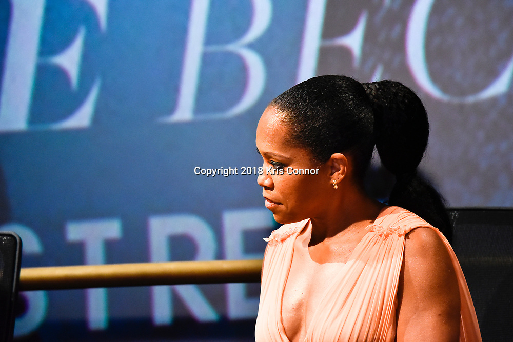 """WASHINGTON, DC - OCTOBER 27: Actress Regina King speaks during a Q&A during the closing night screening of """"IF BEALE STREET COULD TALK"""" at the inaugural Smithsonian African American Film Festival 2018 at National Air and Space Museum in Washington DC on October 27th, 2018. (Photo by Kris Connor/Annapurna Pictures)"""