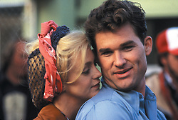 RELEASE DATE: April 13, 1984 <br /> MOVIE TITLE: Swing Shift <br /> STUDIO: A Lantana Production <br /> DIRECTOR: Jonathan Demme<br /> PLOT: In 1941 America Kay and her husband are happy enough until he enlists after Pearl Harbor. Against his wishes, his wife takes a job at the local aircraft plant where she meets Hazel, the singer from across the way to whom she hadn't previously been all that nice. The two soon become firm friends and with the other girls become increasingly expert workers able to ride the jibes of the male workforce. As the war drags on Kay finally goes on a date with her trumpet playing foreman and life inevitably starts to get complicated <br /> PICTURED: GOLDIE HAWN as Kay Walsh and KURT RUSSELL as Mike 'Lucky' Lockhart <br /> (Credit Image: © A Lantana Production /Entertainment Pictures/ZUMAPRESS.com)