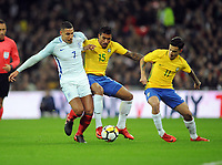 Football - 2017 / 2018 International Friendly - England vs. Brazil<br /> <br /> Jake Livermore of England is challenged by Paulinho and Philippe Coutinho of Brazil at Wembley.<br /> <br /> COLORSPORT/ANDREW COWIE