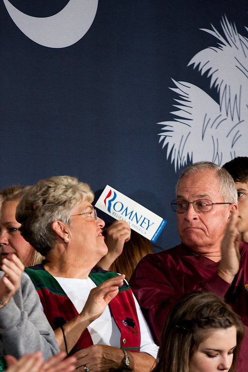 Two Mitt Romney supporters clap for their candidate as he walked out on stage at Winthrop University.