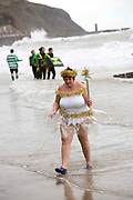 A Christmas fairy survives the sea. Participants dressed up for Folkestone Lions Club Boxing Day Dip.  An annual fancy dress fundraising event, where all sorts of amusing costumes and characters enter the cold sea of the English Channel at Sunny Sands, Folkestone. UK.