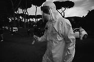 The collection of swab samples by medical staff  in the drive-in testing center of San Filippo Neri hospital in Roma to check the Coronavirus (Covid-19)<br />Health workers are dressing with protective suits and face maks.