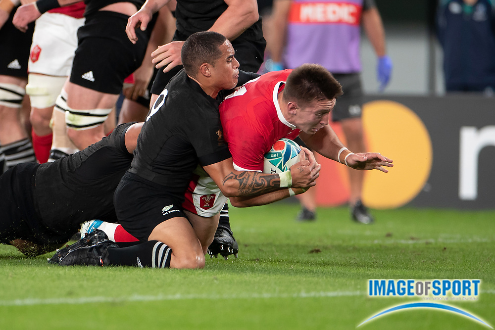 Josh Adams of Wales is tackled by Aaron Smith of New Zealand during the Rugby World Cup bronze final match between New Zealand and Wales Friday, Nov, 1, 2019, in Tokyo. New Zealand defeated Wales 40-17.  (Flor Tan Jun/Espa-Images-Image of Sport)