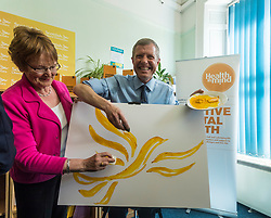 Willie Rennie visits mental health charity, Health In Mind and takes part in painting Liberal Democrat Logos before officially launching the Manifesto for the 2017 General Election.<br /> <br /> <br /> Pictured: Elizabeth Riches candidate for North East Fife and Willie Rennie