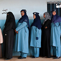 USE ARROWS ← → on your keyboard to navigate this slide-show<br /> <br /> Khartoum, Sudan, 11 April 2010<br /> Sudanese women wait to vote in a polling station during the presidential elections in Sudan.<br /> Photo: Ezequiel Scagnetti