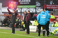 Woking manager Alan Dowson looks on as the fourth official holds up the display board showing 4 minutes added time during the The FA Cup 2nd round match between Swindon Town and Woking at the County Ground, Swindon, England on 2 December 2018.