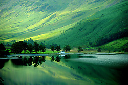 File photo dated 05/09/13 of early autumn reflections in Buttermere in the Lake District in Cumbria, as the Lake District has been designated as a World Heritage Site, Unesco has said.