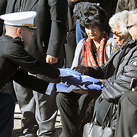 Members of USMC Honor Guard present a burial flag to Betsy Newman, widow of Navajo Code Talker Alfred K. Newman Saturday at funeral services held in Farmington.