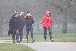 ©️ Licensed to London News Pictures. 07/02/2021. London,UK. Members of the public enjoy walking through Primrose Hill in London as Storm Darcy hits the UK this morning with freezing temperatures and heavy snow forecast. The Met Office have issue numerous weather warnings today for snow and ice with disruption to travel. Photo credit: Marcin Nowak/LNP
