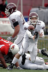04 November 2006:Tyler Horner shuffles off a lateral before Kaschiev Hunter can right himself to make a sack. In a decisive victory, the Illinois State Redbirds defeat the Missouri State Bears 38-14 at Hancock Stadium on the campus of Illinois State University in Normal Illinois.<br />