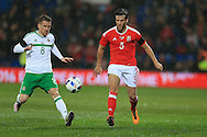 Adam Matthews of Wales ® is challenged by Steven Davis of Northern Ireland. Wales v Northern Ireland, International football friendly match at the Cardiff City Stadium in Cardiff, South Wales on Thursday 24th March 2016. The teams are preparing for this summer's Euro 2016 tournament.     pic by  Andrew Orchard, Andrew Orchard sports photography.