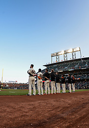 April 30, 2018 - San Francisco, CA, U.S. - SAN FRANCISCO, CA - APRIL 30: San Francisco Giants Pitcher Hunter Strickland (60) and San Francisco Giants Right field Andrew McCutchen (22) standing with team mates for the National Anthem during  the San Francisco Giants and San Diego Padres game on April 30, 2018 at AT&T Park in San Francisco, CA. (Photo by Stephen Hopson/Icon Sportswire) (Credit Image: © Stephen Hopson/Icon SMI via ZUMA Press)