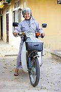 Nuns and motorbikes, Chua Dieu Vien Pagoda, Hue, Vietnam.  Photo by Stan Olszewski/SOSKIphoto