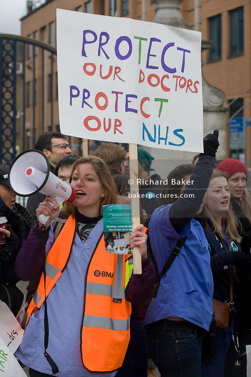 London, UK. 12th January 2016. National Health Service (NHS) Junior Doctors under the banner of the British Medical Association (BMA) man a picket line outside Kings College Hospital in Camberwell, south London. The one-day strike is over pay and working conditions, the first such industrial action in 40 years.
