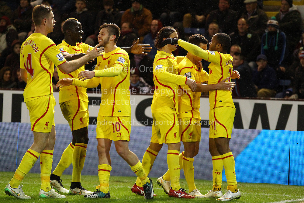 Raheem Sterling of Liverpool (r) celebrates with his teammates after scoring his teams 1st goal. Barclays Premier league match, Burnley v Liverpool at Turf Moor in Burnley, Lancs on Boxing Day, Friday 26th December 2014.<br /> pic by Chris Stading, Andrew Orchard sports photography.