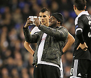A pitch invader comes onto the pitch to have a selfie with Tottenham's Erik Lamela<br /> <br /> Europa League Group C- Tottenham vs Partizan Belgrade - White Hart Lane - England - 27th November 2014 - Picture David Klein/Sportimage