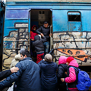 Refugees board a train that will depart soon to the Croatian-Serbian border. The majoirty are on their way to Western Europe, with the hope of finding a peaceful future. Presevo, Serbia, January 2016.