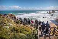 Tourists enjoy the dramatic coastal landscape at the Twelve Apostles viewpoint on Australia's Great Ocean Road in Victoria state.