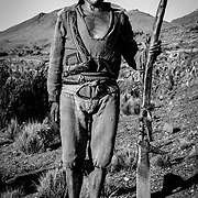 """Quechua peasant farming with the use of this """"chaquitajlla"""" –an upright plouh used since pre-Colombian times. Willoq, Peru."""