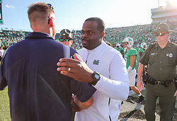 Oct 9, 2021; Huntington, West Virginia, USA; Marshall Thundering Herd head coach Charles Huff talks with Old Dominion Monarchs head coach Ricky Rahne following the game at Joan C. Edwards Stadium. Mandatory Credit: Ben Queen-USA TODAY Sports