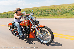Jodie Weiss of Redwing, MN rides back to Sturgis after the annual Michael Lichter - Sugar Bear Ride hosted by Jay Allen with the Easyriders Saloon during the Sturgis Black Hills Motorcycle Rally. SD, USA. Sunday, August 3, 2014. Photography ©2014 Michael Lichter.