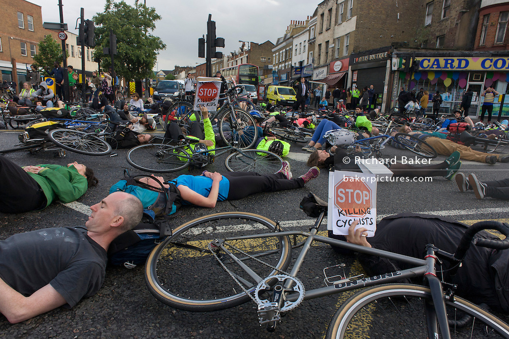 Cyclists protesting about another death nearby lie at Camberwell Green in the south London borough of Lambeth. On 28th May, NHS Physiotherapist Esther Hartsilver was killed by a left-turning lorry, 100m from this location. Esther was the 6th cycling casualty this year, the 5th woman to die and all those incidents involving heavy lorries. Supporters of the action group Stop Killing Cyclists organsided the die-in, stopping traffic at this major road junction.