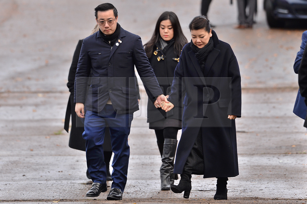 © Licensed to London News Pictures. 28/11/2018. Leicester, UK. Aiyawatt Srivaddhanaprabha, mother Aimon and daughter, Voramas visit a tribute site near Leicester City Football Club King Power Stadium to pay tribute to those who were tragically killed in the helicopter crash at Leicester City Football Club's King Power Stadium. Their Royal Highnesses knew the Club's Chairman, Vichai Srivaddhanaprabha, and wanted to visit the city to recognise the warmth and compassion that the people of Leicester and fans of Leicester City Football Club have shown in reaction to the accident. Photo credit: Ray Tang/LNP