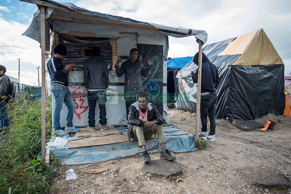 October 22, 2016 - Calais, France - Migrants waiting for th eviction day. Calais, France on 22 October 2016 As the date of the eviction gets closer, the migrants and refugees of jungle are thinking about their options. Some have decided to to leave the camp before the start of the dismantling, others are willing to stay in France and therefore to follow with the plan of entering a center. (Credit Image: © Guillaume Pinon/NurPhoto via ZUMA Press)