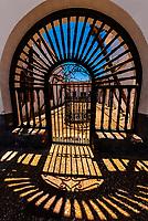 Shadows of a gate,  Barrio de Cuevas section of Guadix, Granada Province, Andalusia, Spain.