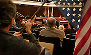 The Salt Lake City Council, seen through Peter Liacopoulos's upside-down U.S. flag during the second public hearing regarding the proposed 2013 Salt Lake County budget and tax increases at the Salt Lake County Government Center, Thursday, Dec. 13, 2012.